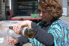New Zealand Whisky Co manager Deb Preston celebrates the shipment of whisky about to begin its journey from Oamaru to the home of the whisky, Scotland. Photo / David Bruce.