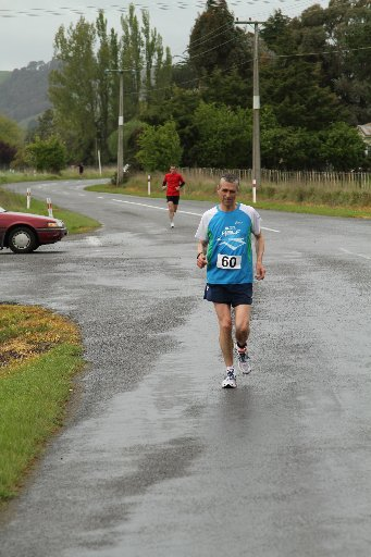 Te Whiti Road, Masterton. Marathon runners on the course competing in the Wairarapa Country Marathon.