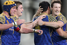 Otago captain Glenn Dickson, Jackson Hemopo, Michael Collins and Hugh Blake celebrate their victory over Tasman. Photo / Getty Images