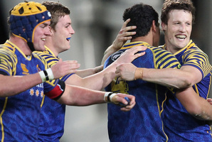 Otago captain Glenn Dickson, Jackson Hemopo, Michael Collins and Hugh Blake celebrate their victory over Tasman. Photo / Getty Images