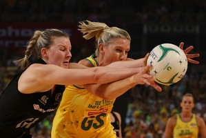 Catherine Cox of Australia and Katrina Grant of the Silver Ferns compete for the ball. Photo / Getty Images