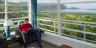 View: Bush, beach and comfort in Piha