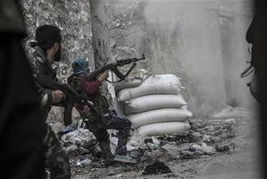 A rebel fighter retreats for cover as enemy fire targets the rebel position during clashes at the Moaskar front line. Photo / AP