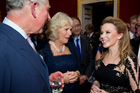 Australian pop singer Kylie Minogue meets Britain's Prince Charles and his wife Camilla, Duchess of Cornwall at St James's Palace in central London. Photo / AP