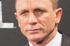 Daniel Craig says Adele's theme tune for Skyfall moved him to tears. Photo / AP