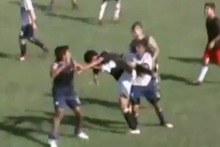 Players from Teniente Farina and Libertad engage in a mass brawl which resulted in 36 red cards. Photo / Youtube