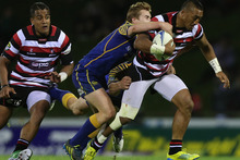  Rey Lee Lo of Counties Manukau is tackled during the ITM Cup Championship Final match between Counties Manukau and Otago. Photo / Getty Images.