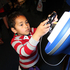 A child checks out a new gadget at the Armageddon Expo 2012. Photo / NZ Herald