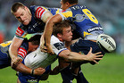 Bulldog Trent Hodkinson offloads against the Cowboys. He is wanted by the Warriors. Photo / Mark Nolan