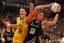Irene van Dyk, here fighting Bianca Chatfield for the ball, believes the Ferns were caught off-guard by the Australians' rampant start. Photo / Getty Images