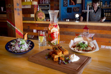 Takapuna Mexico's ceviche, patatas de maiz and chicken taco with a jug of sangria. Photo / Natalie Slade