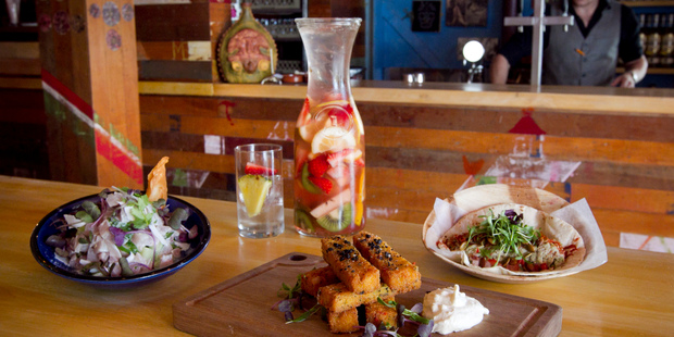Takapuna Mexico's ceviche, patatas de maiz and chicken taco with a jug of sangria. Photo / Natalie Slade