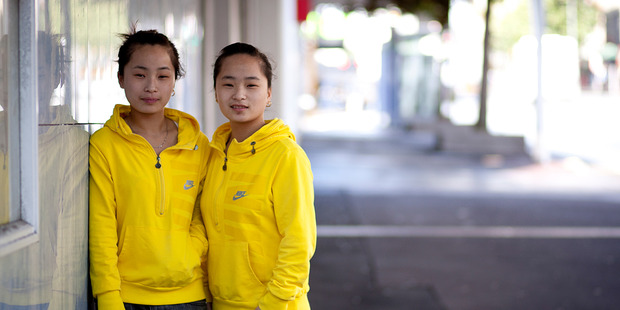 Sining Geng (left) and sister Sixia were assured by an agent their application would be successful. Photo / Dean Purcell