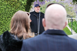 Kim Dotcom speaks to guests at the party at his mansion. Photo / Supplied