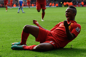 Raheem Sterling celebrates scoring on debut. Liverpool wants to nurture his development.  Photo / Getty Images