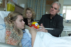 Gerri and Jim Steinke at their daughter Kirsten's bedside. Photo / Supplied