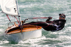 Olympian Jo Aleh rolls back the years as she tries out her old P Class yacht. Photo / Brett Phibbs
