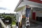 Builder Shane Howe makes repairs to the Cameron Rd property which was hit by a car. Photo / Bay of Plenty Times
