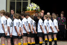 Family pallbearers carry the casket through an honour guard of junior rugby players outside the Holy Trinity Cathedral in Parnell. Photo / Brett Phibbs
