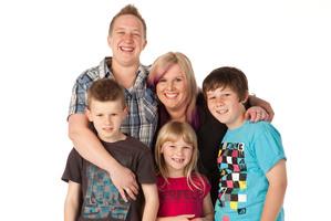 Amanda Fail and Jay Blair with their family. Photo / Supplied