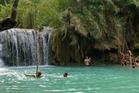 Bathers at Kuang Xi waterfalls near Luang Prabang, Laos. Photo / Supplied