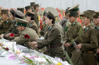 North Korean soldiers offer flowers in front of the statues of the country's founding ruler Kim Il Sung. Photo / AP