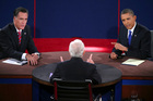 Republican presidential nominee Mitt Romney and President Barack Obama answer a question during the third presidential debate at Lynn University. Photo / AP