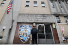 A police officer stands guard outside the 26th precinct where police officer Gilberto Valle worked in New York. Photo / AP