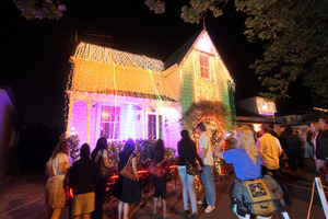 Thousands of people enjoy the Christmas lights on Ponsonby residents' homes in Franklin Rd each year.   Photo / Bradley Ambrose