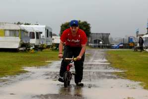 Josh Townley 14, from Auckland has some fun in the rain at the Kopua Holiday Park at Raglan. Photo / NZ Herald