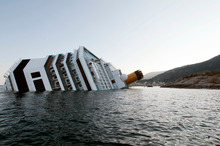 Francesco Schettino The Costa Concordia is impaled on two rocky spikes off the tourist beaches of Giglio Island. Photo / Gregorio Borgia