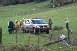 Police and firefighters at the scene of a fatal quad bike accident on a rugged Awarua farm in 2010. File photo / APN