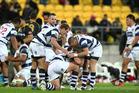 Auckland captain Daniel Braid is congratulated by his team-mates. Photo / Justin Arthur