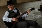 Elvis Costello is bringing his band The Imposters. Photo / Supplied