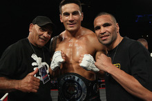 Sonny Bill Williams poses with former trainer Tony Mundine (L) and Anthony Mindine after winning the Battle for the Belt match