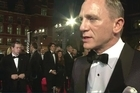 "Daniel Craig thrilled James Bond fans in London Tuesday when he stepped onto the red carpet with co-stars Judi Dench and Javier Bardem for the world premiere of the 23rd Bond film ""Skyfall""."