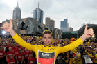 Cadel Evans celebrates with fans after winning last year's Tour de France. Photo / Getty Images