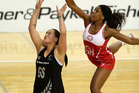 Cathrine Latu shoots under pressure from Eboni Beckford-Chambers of England. Photo / Getty Images