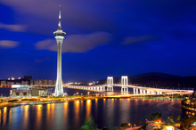 The Macau Tower looms over Macau at night. Photo / Thinkstock