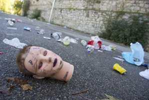 A doll head and rubbish at the car park of the Madrid Arena stadium in Madrid, where three young women died during a Halloween celebration. Photo / AFP