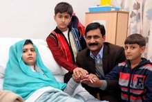 Pakistani schoolgirl Malala Yousafzai, who was shot in the head by Taliban gunmen for campaigning for the right to an education, with her brothers and father. Photo / AFP