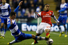 Reading's Sean Morrison, left, vies for the ball with Arsenal's Jernade Meade during the English League Cup soccer match between Reading and Arsenal at Madejski Stadium in Reading. Photo / AP
