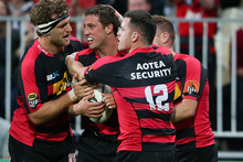 Canterbury player Tom Taylor celebrates after scoring his first try with team mates. Photo / Getty Images.