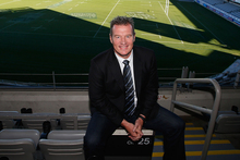 John Kirwan, the coach for the Auckland Blues poses for media representatives at Eden Park. Photo / Getty Images.