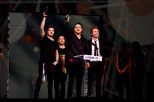 Six60 salutes the audience after receiving one of their six music award last night. Photo / Dean Purcell