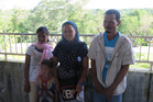 Bing Mangisig (centre) and her family fled when their village was seized by a breakaway rebel group. Photo / Nicholas Jones