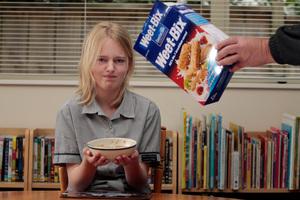 Baje Charman, 13, doesn't enjoy breakfast since the earthquake.  Photo / Michael Craig