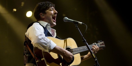 Marcus Mumford in full cry at Vector Arena in Auckland last night. Photo / Steven McNicholl
