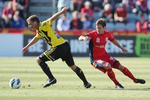 Phoenix defender Ben Sigmund eludes Adelaide's Jeronimo Neumann. Photo / Getty Images