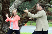 Rachel Grunwell takes a Qigong class with Henri-Noel Venturini at Auckland Domain. Photo / Doug Sherring